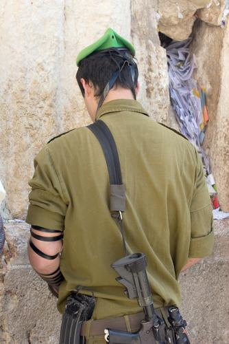 Soldier praying at the Western Wall
